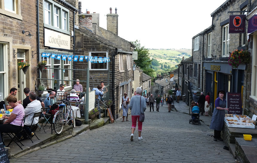 The Main Street in Haworth, where the Brontë sisters spent most of their lives. Haworth is a former mill town in West Yorkshire, England.