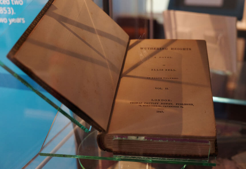 A first edition of Emily Brontë's novel Wuthering Heights on display at the Brontë Parsonage Museum in Haworth. Like Charlotte, Emily originally published under a male pseudonym.