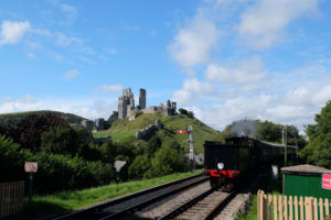 A steam train in the heritage railway station at Corfe Castle, Dorset