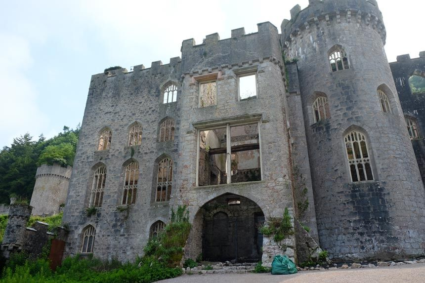 The main house at Gwrych Castle is in a sad state, open to the elements with no roof. The four-storey castle with a tower has several arched windows, all of which are missing their glass. It feels pretty spooky even in the sunshine.