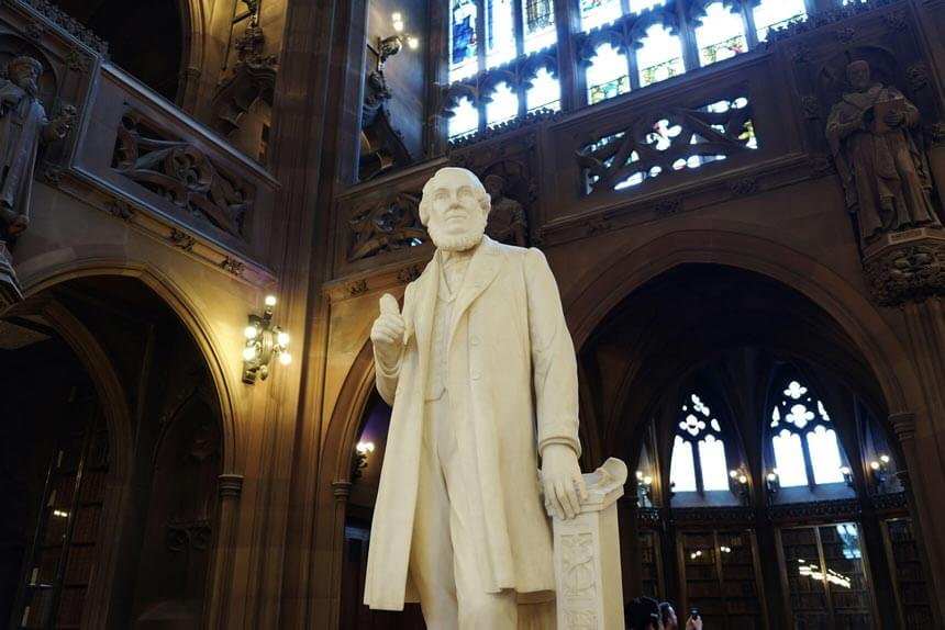 A white marble statue of John Rylands, inside the library that bears his name.